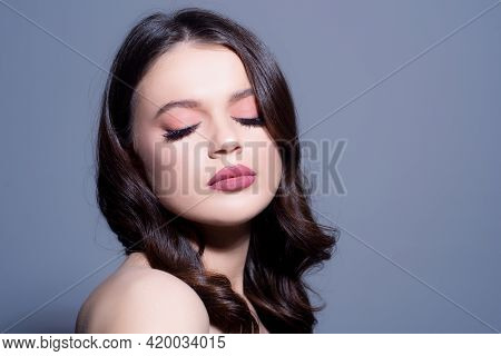 Sensual Girl With Perfect Fresh Skin And Shiny Hair, Beautiful Woman With Nude Make-up With Eyes Clo