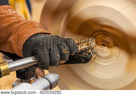 Turning A Wooden Part On A Lathe. Carpentry Work. Mechanical Woodworking
