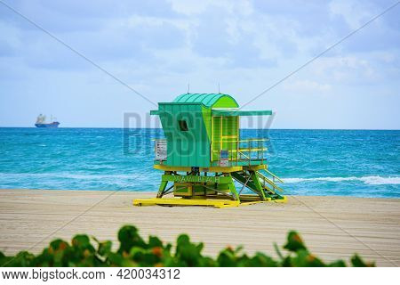 Miami South Beach Lifeguard Tower And Coastline With Cloud And Blue Sky.
