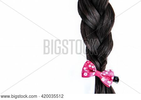 Black Braided Hair Isolated On White Background. Brunette Natural Braided Hair Extension On White Ba
