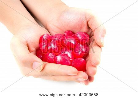 Close Up Of Love Candy In Feminine Hand