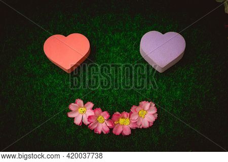 Abstract Art Wall Paper Colorful Heart Shape On Green Grass Background. Beauty Nature Wall Copy Spac