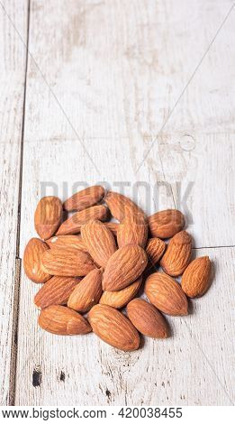 Almonds On A Wooden Floor, Almonds Are Placed On The Wooden Floor At The Bottom Of The Image, Copy S