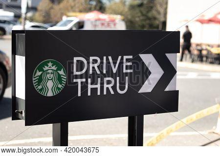Courtenay,canada - April 22,2021: Cars Lining Up To Order Food Using Drive-thru Facilitiy At Local S