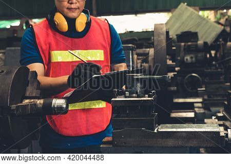 Skillful Factory Worker Working With Clipboard To Do Job Procedure Checklist . Factory Production Li