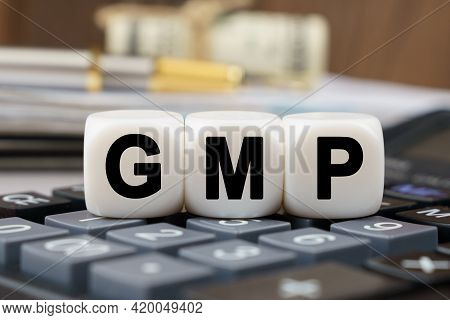 Business And Finance Concept. There Are Cubes On The Calculator That Say - Gmp