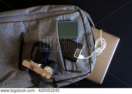 Modern Gadgets - Mirrorless Camera, Laptop Or Ultrabook, Smartphone And Tablet, Lie In A Gray City B