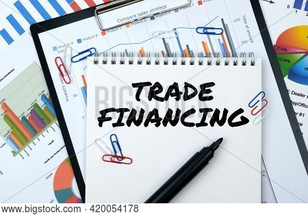 Business And Finance. On The Table Are Reports, Charts, A Notebook With The Inscription - Trade Fina