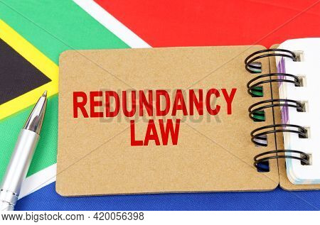 Law And Justice Concept. Against The Background Of The Flag Of South Africa Lies A Notebook With The