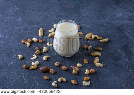 Glass Of Organic Vegan Dairy Free Milk From Nuts. Healthy Vegetarian Alternative Drink. Various Type