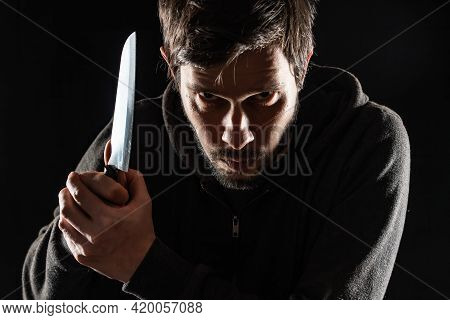 Scary And Evil Maniac Or Murderer With Knife On Black Background.