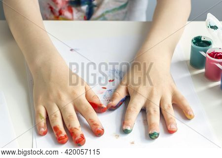 Palms Painted On Childrens Hands With Multi-colored Paints. Childs Hobby Creativity And Art. Childre