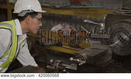 Asian Professional Mechanical Engineer Or Operation Man Wearing Uniform Goggles Safety Working On Wo