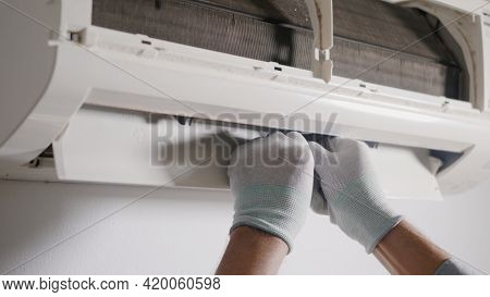 Technician Service Checking And Repair Air Conditioner House Indoors On The Wall, Young Man Electric