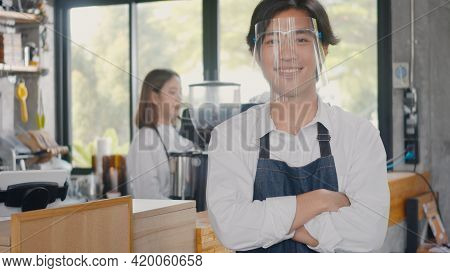 Portrait Of Happy Handsome Young Man Confident Cafe Owner Standing Crossed Arms On Front Counter Bar