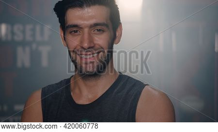 Close Up Portrait Of Handsome Fitness Man In Gym, Personal Trainer Standing Showing His Muscles With