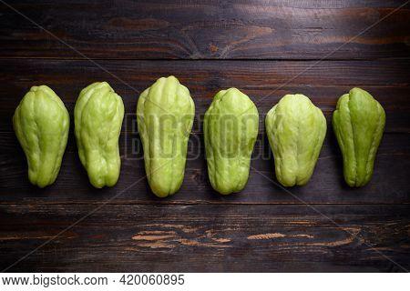 Chayote Squash Fruit (mirliton, Pipinola Or Choko) On Wooden Background, Edible Fruit Eaten Both Coo