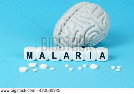 Medicine And Health. Cubes Lie On The Table Among The Pills And Imitation Of The Brain. The Text On