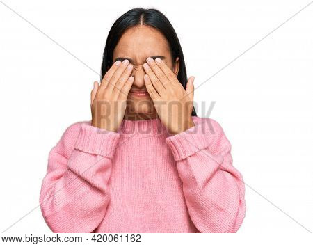 Young asian woman wearing casual winter sweater rubbing eyes for fatigue and headache, sleepy and tired expression. vision problem