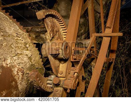 Close Up Of A Old Cement Mixer Gearing Section.