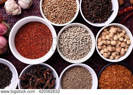 Various Dry Spices And Herbs In A Bowl. Asian Food Ingredients (chili, Clove, Caraway, Coriander See