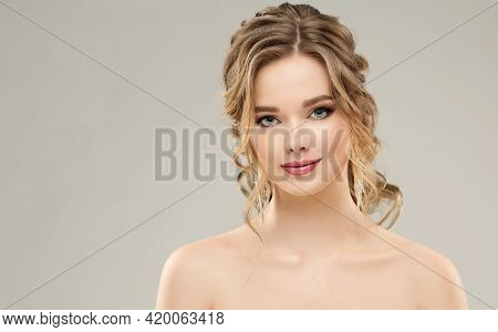 Beauty Woman Make Up Face. Fashion Model Bridal Makeup And Hair Style Portrait. Elegant Bride Weddin