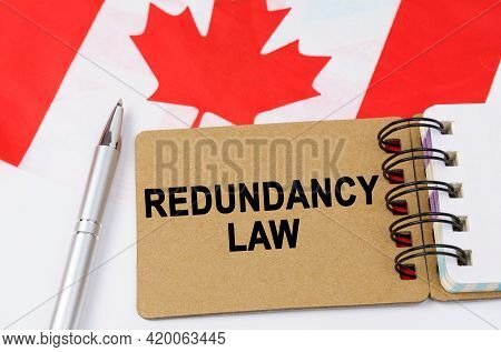Law And Justice Concept. Against The Background Of The Flag Of Canada Lies A Notebook With The Inscr