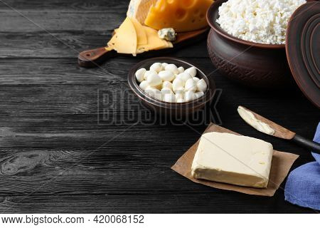 Clay Dishware With Fresh Dairy Products On Black Wooden Table, Space For Text