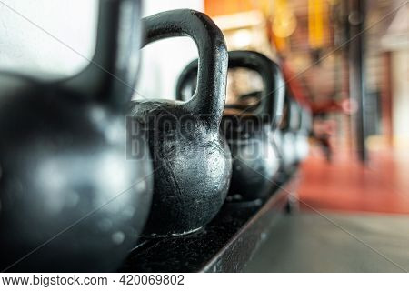 Kettlebells On The Background Of The Interior Of The Gym Without People