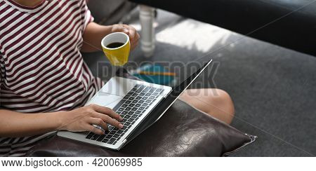 Cropped Image Of Smart Man Working As Programmer Drinking A Coffee While Typing On Computer Laptop T