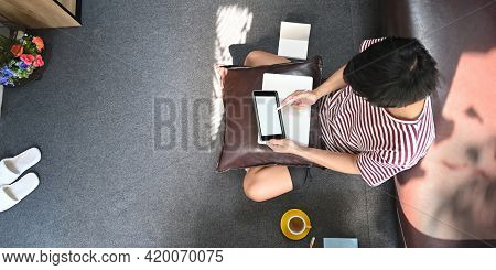 Top View Image Of Creative Man Drawing On White Blank Screen Computer Tablet By Stylus Pen While Sit