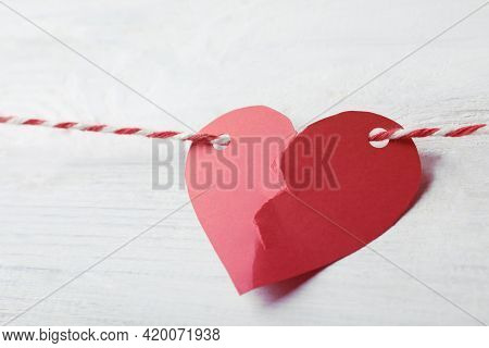 Broken Red Paper Heart And Rope On White Wooden Table, Closeup. Cheating Concept