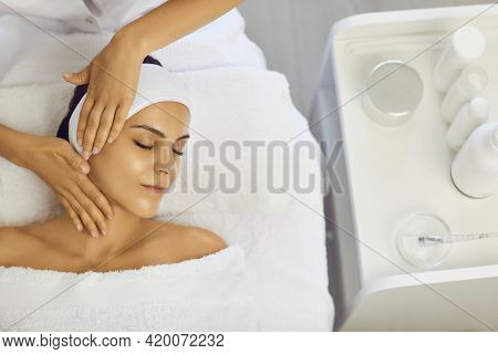 Cosmetologist Making Professional Manual Relaxing Rejuvenating Massage For Young Woman