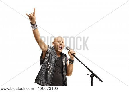 Rock star singing on a microphone and gesturing rock and roll sign isolated on white background