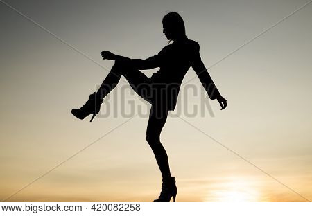 Get Up And Get Moving. Dance Girl. Girl Silhouette On Evening Sky. Female Performer