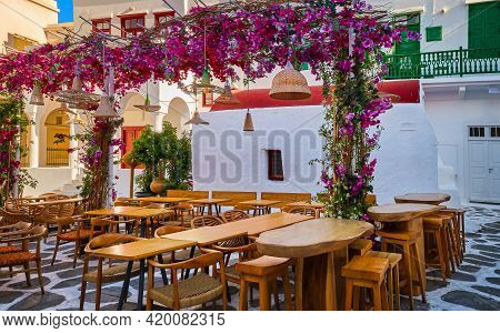 Cozy Outdoor Dining, Cafe, Restaurant, Taverna In Small Greek Square, Whitewashed Chapel, Vibrant Pi