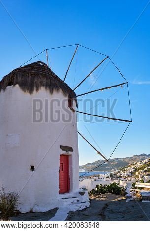 Famous Tourist Attraction Of Mykonos, Greece. Traditional Whitewashed Windmill On Hilltop. Sundown,