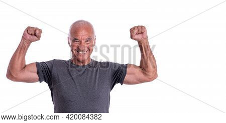 An Elderly Man, An Athlete In Excellent Physical Shape, Celebrates A Victory With Cheerful Emotions.