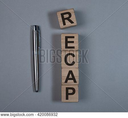 Recap Word Text On Wooden Cube Blocks. Summary Concept