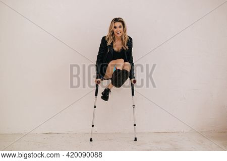Woman Jumping On Castles. Accident . Funny Photo. Rehabilitation And Recovery From Trauma. Kineso Ta