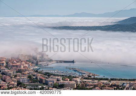 The Citadel Of Calvi In The Balagne Region Of Corsica Under A Veil Of Cloud