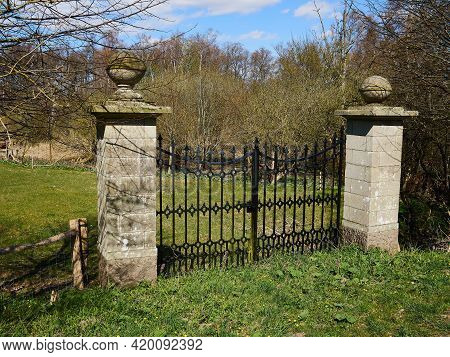 Classical Design Black Wrought Iron Gate In A Beautiful Green Garden House Yard