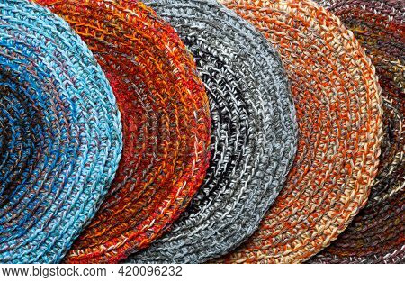 Several Round, Colored Mats Crocheted From Thick Threads. Top View