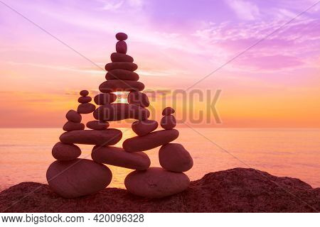Stones Balance On A Background Of Sea Sunset. Calm And Meditation. Concept Of Harmony And Life Balan