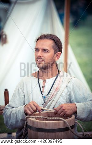 Moscow, Russia - June 23, 2013: Medieval Cooper Making A Barrel During The Great International Yearl