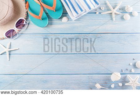 Summer Holiday, Travel And Vacation Concept. Sunglasses, Starfish, Beach Hat, Flip Flop And Sea Shel