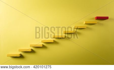 Concept Of Building Success Foundation. Yellow And Red Wooden Block Stacking As Step Stair, Success