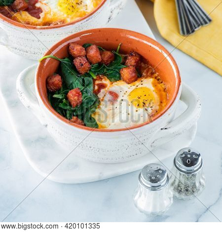 Baked Eggs In Mini Soup Crocks With Sauteed Spinach And Crispy Chorizo Sausage. Ready For Eating.