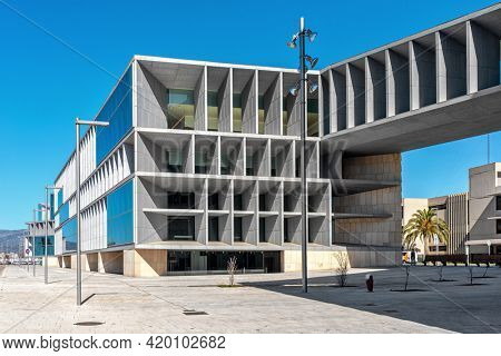 PALMA, SPAIN - MAY 10, 2019: View of modern Convention Centre building and city street under blue sky in Palma - capital city of Balearic islands, famous tourist resort and travel destination.