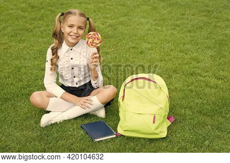 Back To School. Funny Child Hold Lollipop. Concept Of Education. Ordinary Learning Day. Cute Girl Re